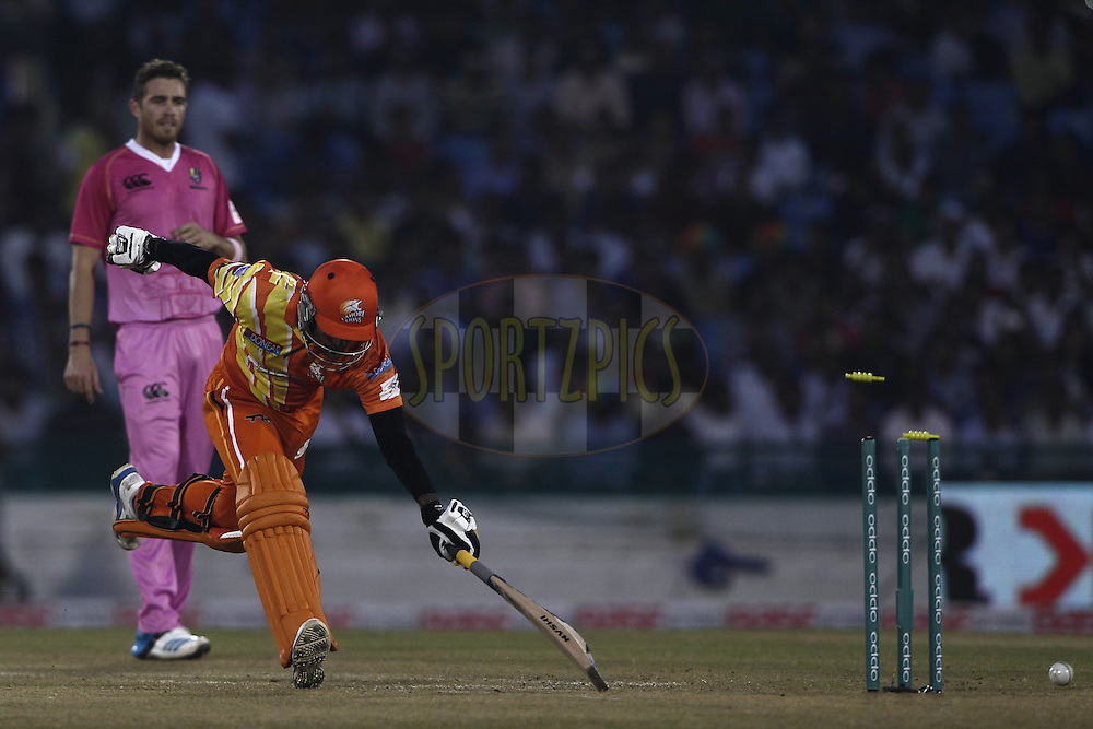 Mohammad Hafeez Captain of the LAHORE LIONS during the qualifier 3 match of the Oppo Champions League Twenty20 between the Northern Knights and the Lahore Lions held at the Chhattisgarh International Cricket Stadium, Raipur, India on the 14th September 2014<br /> <br /> Photo by:  Deepak Malik / Sportzpics/ CLT20<br /> <br /> <br /> Image use is subject to the terms and conditions as laid out by the BCCI/ CLT20.  The terms and conditions can be downloaded here:<br /> <br /> http://sportzpics.photoshelter.com/gallery/CLT20-Image-Terms-and-Conditions-2014/G0000IfNJn535VPU/C0000QhhKadWcjYs