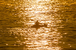 © Licensed to London News Pictures. 07/08/2020. Scarborough UK. A Kayaker heads out to sea this morning on the Yorkshire coast just after sunrise. Photo credit: Andrew McCaren/LNP