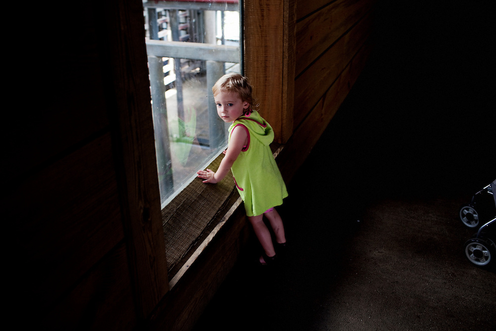 Madelyn Avery Eich, 2, peers into the elephant pens in search of animals at the Norfolk Zoo on Saturday, May 1, 2010.