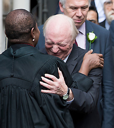 © Licensed to London News Pictures. 20/06/2016. London, UK. An emotional NEIL KINNOCK being greeted by REVEREND ROSE HUDSON-WILKIN as he leaves St Margaret's Church, Westminster Abbey after taking part in a Service of Prayer and Remembrance to commemorate Jo Cox MP, who was killed in her constituency on June 16, 2016. Photo credit: Peter Macdiarmid/LNP