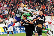 Jens Lehmann collides with rival goalkeeper Manuel Neuer whilst attempting to score for VFB Stuttgart against FC Schalke. 17th October 2009.