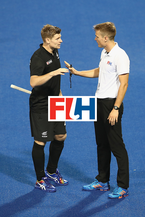 RIO DE JANEIRO, BRAZIL - AUGUST 07:  Stephen Jenness of New Zealand speaks to umpire Marcin Grochal during the men's pool A match between Great Britain and New Zealand on Day 2 of the Rio 2016 Olympic Games at the Olympic Hockey Centre on August 7, 2016 in Rio de Janeiro, Brazil.  (Photo by Mark Kolbe/Getty Images)