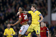 Nottingham Forest forward, on loan from Brighton & Hove albion, Chris O'Grady and Leeds United defender Liam Cooper in another battle during the Sky Bet Championship match between Nottingham Forest and Leeds United at the City Ground, Nottingham, England on 27 December 2015. Photo by Simon Davies.