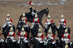 © licensed to London News Pictures. London, UK 22/03/2013. The Household Cavalry Mounted Regiment parades onto Horse Guards Parade to prove their ceremonial skills to Major General George Norton CBE, Officer Commanding the Army in London and the Household Division, ahead of a busy summer of pageantry. Photo credit: Tolga Akmen/LNP
