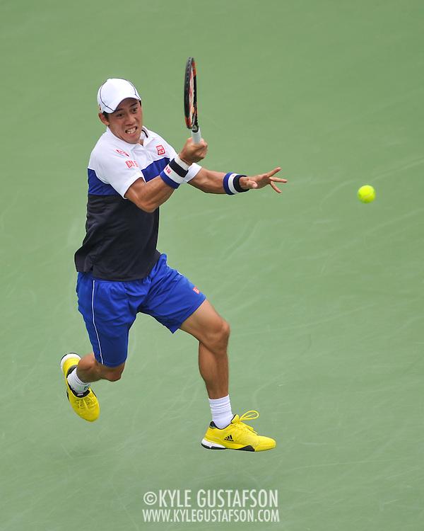 KEI NISHIKORI of Japan plays against Sam Groth of Australia at Day 5 of the Citi Open at the Rock Creek Tennis Center in Washington, D.C. Nishikori won in straight sets.