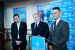 © under license to London News Pictures.  29/11/10 HIV/AIDS sufferer Kristen Johns speaks at the launch while Boris Johnson and Chris Davis of body shop look on.  Boris Johnson unveils the Body Shop 'Be An Activist. Join the Fight Against Aids' exhibition, featuring photography by Rankin to mark World AIDS day at City Hall. Photo credit should read: Olivia Harris/ London News Pictures