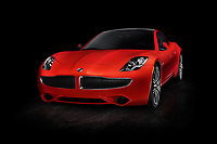 Red 2018 Karma Revero plug-in hybrid electric luxury sports sedan, successor of Fisker Karma electric car. Isolated on black background with clipping path.