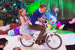 Ryan Tubridy is pictured with toy demonstrators Ruby Spring (8) from Cavan on the Late Late Toy Show 2014. Picture Andres Poveda