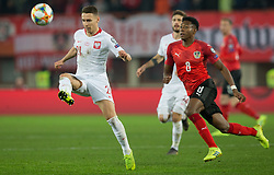 March 21, 2019 - Vienna, Austria - Przemyslaw Frankowski of Poland and David Alaba of Austraduring the UEFA European Qualifiers 2020 match between Austria and Poland at Ernst Happel Stadium in Vienna, Austria on March 21, 2019. (Credit Image: © Foto Olimpik/NurPhoto via ZUMA Press)