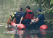 © Licensed to London News Pictures. 09/09/2014. Hanwell, UK Sniffer dogs are used in boats to aid with the search. Police continue to cordon off a section of the Grand Union Canal in Isleworth in the search for missing school girl Alice Gross today 9th September 2014.  Alice Gross of Hanwell, west London, was last seen by her family at about 13:00 BST on 28 August. CCTV footage shows her walking along the Grand Union Canal tow path near the Holiday Inn at Brentford Lock between 13:30 BST and 17:30 BST.. Photo credit : Stephen Simpson/LNP