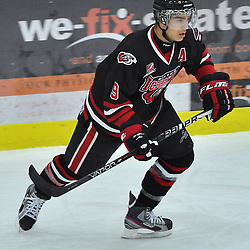 COBOURG, ON - Oct 12 : Ontario Junior League Game Action between, Milton Icehawk's Hockey Club and the North York Ranger's Hockey Club at the OJHL Governors Showcase Tournament. #9 Kane Elliot of the Milton Icehawks skates after the puck during third period game action..(Photo by Jennifer-Rose DeVincentis / OJHL Images