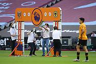 Staff in masks dismantle the Premier League arch during the Premier League match at the London Stadium, London. Picture date: 20th June 2020. Picture credit should read: David Klein/Sportimage