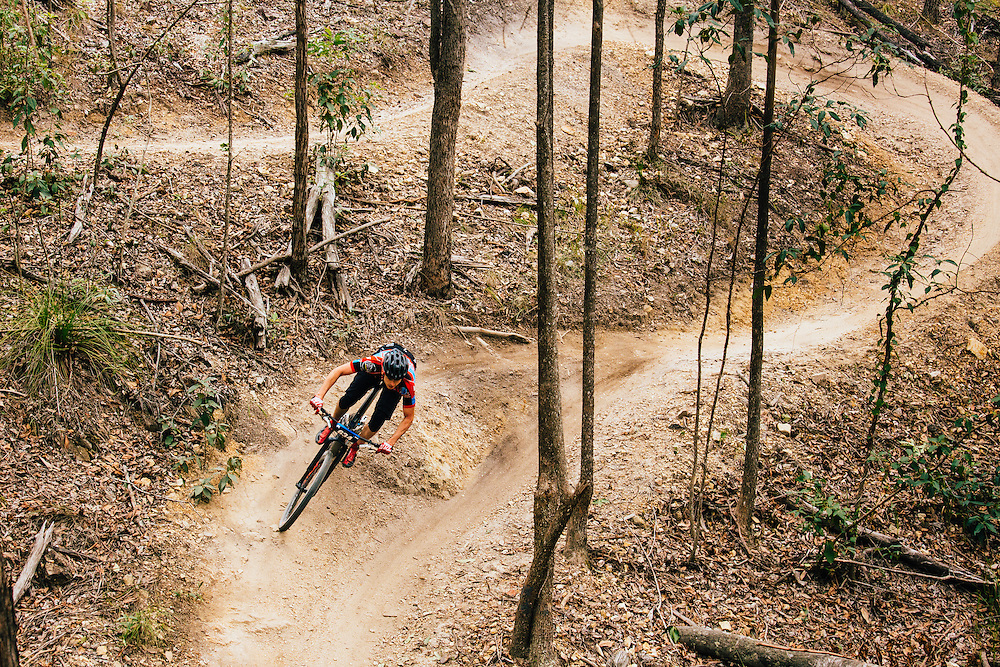 A mountain biker competing in the cross country mountain bike race 'Bayview Blast' in Bayview Conservation Park.