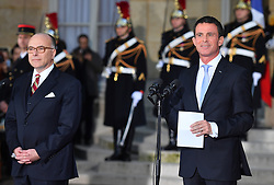 Newly appointed French Prime minister Bernard Cazeneuve and outgoing French Prime Minister Manuel Valls during a ceremony of transfer of power, at the Hotel Matignon in Paris, France, on December 6, 2016. Valls has resigned to declare himself a candidate for the presidency, four days after President Francois Hollande announced he would not seek re-election next May 2017. Photo Christian Liewig Abacapress.com