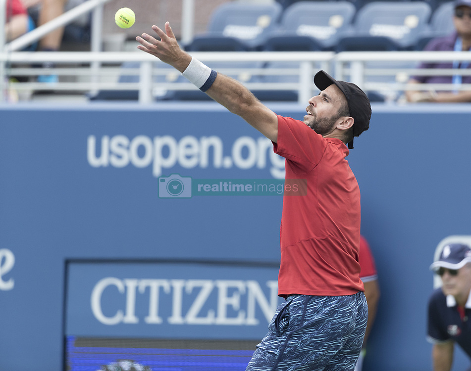 August 31, 2017 - New York, New York, United States - Adrian Menendez-Maceiras of Spain serves during match against Juan Martin del Potro of Argentina at US Open Championships at Billie Jean King National Tennis Center  (Credit Image: © Lev Radin/Pacific Press via ZUMA Wire)