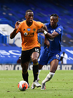 Football - 2019 / 2020 Premier League - Chelsea vs. Wolverhampton Wanderers<br /> <br /> Wolverhampton Wanderers' Willy Boly holds off the challenge from Chelsea's Tammy Abraham, at Stamford Bridge.<br /> <br /> COLORSPORT/ASHLEY WESTERN