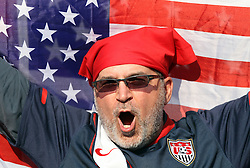 23 JUN 2010:  USA fan in the stands with Stars and Stripes.  The United States National Team played the Algeria National Team at Loftus Versfeld Stadium in Tshwane/Pretoria, South Africa in a 2010 FIFA World Cup Group C match.
