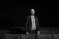 """NAPLES, ITALY - 30 JULY 2018: Roberto Saviano, an Italian journalist, writer and essayis, poses for a portrait at the Nuovo Teatro Sanità, a theatre collective in the Sanità neighborhood, in Naples, Italy, on July 30th 2018.<br /> <br /> In 2017 the 17-year-old innocent victim Genny Cesarano was shot and killed by stray bullet  in cross fire between 2 rival gangs vying for territorial control in the Sanità neighborhood.<br /> The  isolation of the neighborhood Sanità over the years provided an ideal location for the Camorra to expand their illicit activities and profit from soaring unemployment rates and economic instability,<br /> <br /> After the first death threats of 2006 by the Casalese clan , a cartel of the Camorra, which he denounced in his exposé and in the piazza of Casal di Principe during a demonstration in defense of legality, Roberto Saviano was put under a strict security protocol. Since 2006 Roberto Saviano has lived under police protection.<br /> <br /> Saviano's latest novel """"The Piranhas"""", which tells the story of the rise of  a paranza (or Children's gang) and it leader Nicolas, will be released in the United States on September 4th 2018."""
