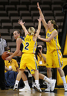 26 JANUARY 2009: Michigan center Krista Phillips (25) tries to get around Iowa guard Kamille Wahlin (2) and Iowa center Megan Skouby (44) during the first half of an NCAA women's college basketball game Monday, Jan. 26, 2009, at Carver-Hawkeye Arena in Iowa City, Iowa. Iowa defeated Michigan 77-69.