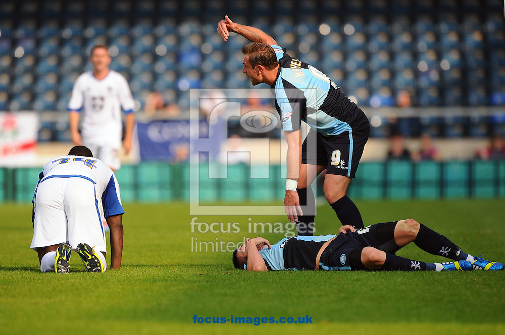 Steven Craig of Wycombe Wanderers and Pablo Mills of Bury go down after colliding during the Sky Bet League 2 match at Adams Park, High Wycombe<br /> Picture by Seb Daly/Focus Images Ltd +447738 614630<br /> 06/09/2014