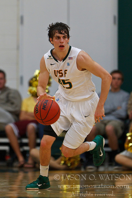 Nov 16, 2011; San Francisco CA, USA;  San Francisco Dons guard Cody Doolin (45) dribbles the ball up court against the San Jose State Spartans during the first half at War Memorial Gym.  San Francisco defeated San Jose State 83-81 in overtime. Mandatory Credit: Jason O. Watson-US PRESSWIRE