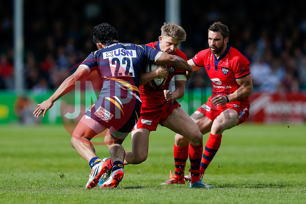 Bristol Rugby Full Back Auguy Slowik is tackled by Worcester replacement Ravai Fatiaki - Photo mandatory by-line: Rogan Thomson/JMP - 07966 386802 - 25/04/2015 - SPORT - Rugby Union - Worcester, England - Sixways Stadium - Worcester Warriors v Bristol Rugby - Greene King IPA Championship.