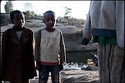 """Children near a small river, where most of the families living in the village supply water for the houses. Shashemene, South Ethiopia, on wednesday, March 19 2008.....""""Shashamene or Shashemene (ethiopian name), located in the Oromia Region of Ethiopia, is """"the place"""", the ancestral homeland. For the whole Rastafarians repatriation to Africa or to Zion or to the Promise Land is the first goal. Rastas assert that """"Mount Zion"""" is a place promised by Jah and they  claim themselves to represent the real Children of Israel in modern times. During the last years of the 40's, Emperor Haile Selassie I, considerated from that movement incarnation of God, donated 500 acres of his private land to members and other settlers from Jamaica including other parts of the Caribbean..The Rastafarian settlement in Shashamane was recently reported to exceed two hundred families. In January 2007 it organized an exhibition and a bazaar in the city. It was also reported recently prior to the Ethiopian Millennium that various pro-Ethiopian World Federation groups, consisting of indigenious Ethiopians and Rastafarians, have given support to one of many five year plans proposed for sustainable development of Shashamene, Ethiopia."""""""