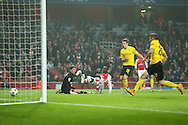 Yaya Sanogo of Arsenal scores the opening goal of the UEFA Champions League match against Borussia Dortmund at the Emirates Stadium, London<br /> Picture by Richard Calver/Focus Images Ltd +447792 981244<br /> 26/11/2014