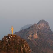 Hilltop Buddha at Wat Khao Tham Talu in Ratchaburi province, Thailand