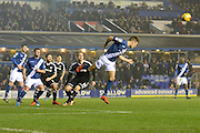 Birmingham City defender Michael Morrison heads away during the Sky Bet Championship match between Birmingham City and Brentford at St Andrews, Birmingham, England on 2 January 2016. Photo by Alan Franklin.