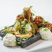 Lamb Jam Seattle Mediterranean contestant: The Barking Frog, Chef Dylan Herrick (olive spiced roast leg of lamb, couscous arancini, sous vide cucumber, anchovy, califlower, charred tomato, pan sauce, feta foam).