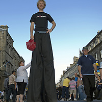 Young man on stilts advertising a show at the Edinburgh Fringe Festival<br />