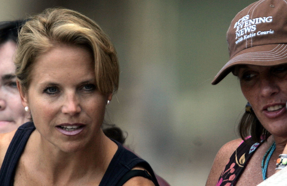 Katie Couric, who starts her new job as the anchor on CBS Evening News on Tuesday 05 September, talks with other fans as she watches the match between Andy Roddick and Fernando Verdasco on the seventh day of the 2006 US Open tennis tournament in Flushing Meadows, New York Sunday, 03 September 2006. The woman at right is unidentified.