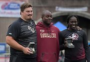 Apr 27, 2018; Philadelphia, PA, USA; Austin Droogsma (left) and Shanice Love of Florida State (right) pose with throws coach Dorian Scott (center) after winning the shot put and women's discus during the 124th Penn Relays at Franklin Field.
