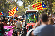 Tractors march along Gran Via de les Corta Catalanes during the protest surrounded by Esteladas, the Catalan independence flag Editorial and Commercial Photographer based in Valencia, Spain |Portraits, Hospitality, News, Sports, Media Coverage for Events