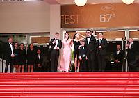 Maxim Emelianov, Zukhra Duishvili, Abdul Khlim Mamamtsuiev, Michel Hazanavicius, Berenice Bejo and Thomas Langmann at The Search gala screening red carpet at the 67th Cannes Film Festival France. Tuesday 20th May 2014 in Cannes Film Festival, France.