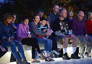 A group of people hold American flags during a candlelight service to honor the victims of the attacks on the World Trade Center Sunday, September 10, 2017 at the Garden of Reflection 9/11 Memorial in Lower Makefield, Pennsylvania. (Photo by William Thomas Cain)