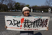 Activist, Sumiko Masunaga holds a sign protesting against the lay judge system (a Japanese version of a jury system) at an anti-war and left wing demonstration in Shibuya, Tokyo, Japan Saturday March 20th 2010