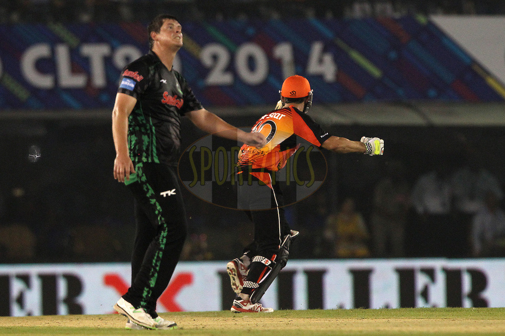 Robert FRYLINCK  of the Dolphins  looks dismayed as Mitchell MARSH of the Perth Scorchers celebrates the win during match 4 of the Oppo Champions League Twenty20 between the Dolphins and the Perth Scorchers held at the Punjab Cricket Association Stadium, Mohali, India on the 20th September 2014<br /> <br /> Photo by:  Ron Gaunt / Sportzpics/ CLT20<br /> <br /> <br /> Image use is subject to the terms and conditions as laid out by the BCCI/ CLT20.  The terms and conditions can be downloaded here:<br /> <br /> http://sportzpics.photoshelter.com/gallery/CLT20-Image-Terms-and-Conditions-2014/G0000IfNJn535VPU/C0000QhhKadWcjYs
