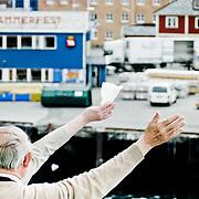 Three weeks aboard the Kong Harald. Hurtigruten, the Coastal Express. Farewell, people waving hands to say goodbye.