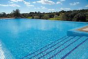 Swimmingpool in grüner Landschaft, Finca Son Mas bei Porto Cristo, Mallorca, Balearen, Spanien.|.swimming pool of Finca Son Mas in green landscape, spring, Mallorca, Spain...