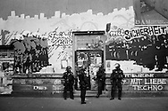 Germany, Frankfurt am Main : Riot policemen take rest past  a painted wall during a demonstration on the opening day of the European Central Bank (ECB) in Frankfurt am Main, western Germany, on March 18, 2015<br /> <br /> .