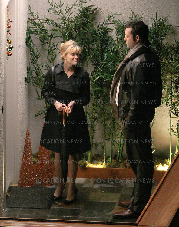 "December 06, 2007 San Francisco, CA. Non Exclusive. Reese Witherspoon And Vince Vaughn film a romantic kissing scene on a San Francisco trolley for their movie ""Four Christmases"". Filming happened during a heavy rain. Vince gives Reese a gentlemanly piggy back ride. Photo By Eric Ford/ On Location News 1/818-613-3955 info@onlocationnews.com"