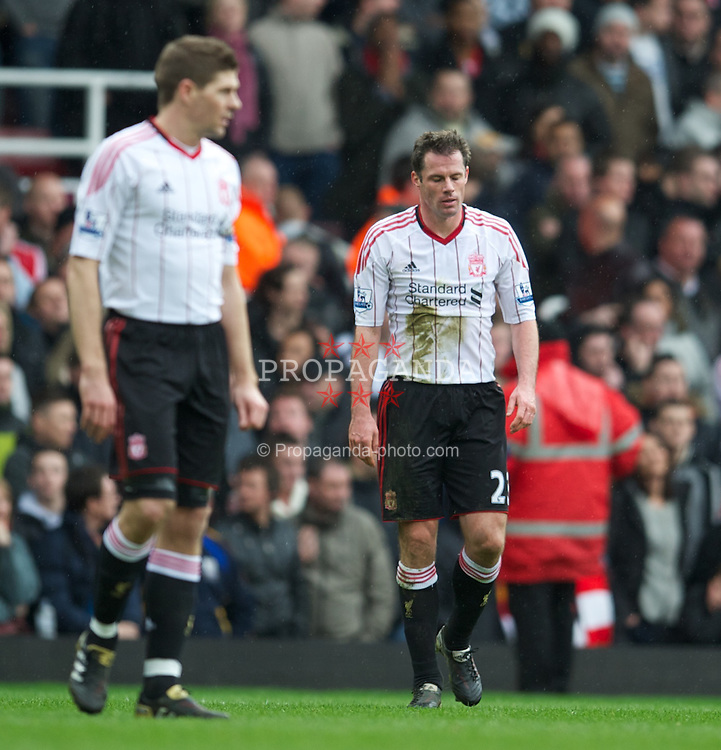 LONDON, ENGLAND - Sunday, February 27, 2011: Liverpool's Jamie Carragher looks dejected as West Ham United score the second goal during the Premiership match at Upton Park. (Photo by David Rawcliffe/Propaganda)