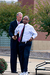 19 September 2009: Doug Collins shakes the hand of Will Robinson Jr. as Will exits the podium. Illinois State University took the day to celebrate 2 of it's own, the late Will Robinson and national hero Doug Collins.  Will Robinson became the first black head basketball coach in NCAA Division I history when names ISU basketball coach in 1970.  Doug Collins was an Illinois State standout basketball player who represented the United States in the 1972 Olympics, played NBA ball for several years where he later coached and recently recieved the Curt Gowdy Media Award for career in broadcasting.  A statue was erected in their honor on the terrace just north of the main entrance to Redbird Arena on ISU's campus in Normal IL