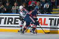 KELOWNA, CANADA - JANUARY 7: Erik Gardiner #12 of the Kelowna Rockets checks Collin Shirley #15 of the Kamloops Blazers on January 7, 2017 at Prospera Place in Kelowna, British Columbia, Canada.  (Photo by Marissa Baecker/Shoot the Breeze)  *** Local Caption ***