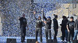 Nov 3, 2015; Kansas City, MO, USA; Kansas City Royals catcher Salvador Perez (13) and third baseman Mike Moustakas (8) celebrate the championship at Union Station. Mandatory Credit: Denny Medley-USA TODAY Sports