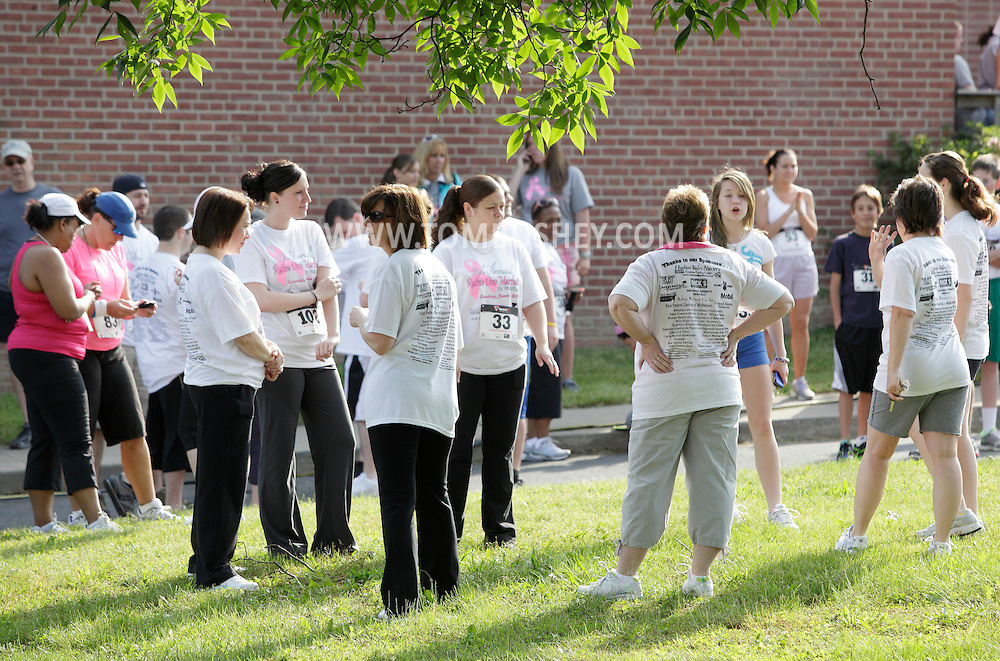 Middletown, New York - Walkers and runners gather before in the 15th annual Ruthie Dino Marshall 5K Run and Fun Walk hosted by the Middletown YMCA on Sunday, June 5, 2011. ©Tom Bushey / The Image Works