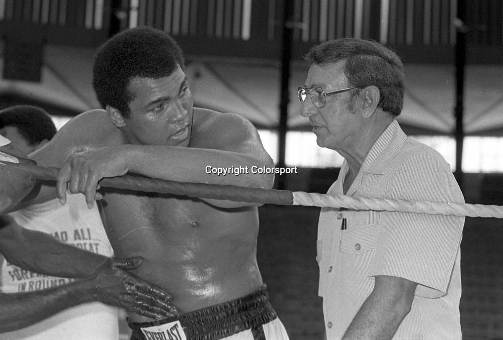 Boxing - World Heavyweight Championship (WBC & WBA) Title Fight - Muhammad Ali vs. Joe Bugner II....Muhammad Ali with cornerman Angelo Dundee during a training session in Kuala Lumpur, Malaysia.