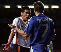 Photo: Paul Thomas.<br /> Chelsea v Valencia. UEFA Champions League. Quarter Final, 1st Leg. 04/04/2007.<br /> <br /> Andriy Shevchenko Blue) of Chelsea and Asier Del Horno don't agree on Del Horno fouling Shevchenko in the box.
